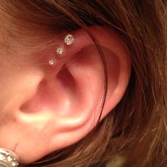 Triple Helix. One piercing for my two sisters and I.