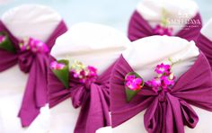 Purple chair back bows with purple orchids