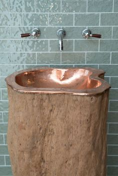 Copper-lined Tree Trunk Basin joins Indigenous' Bathroom .