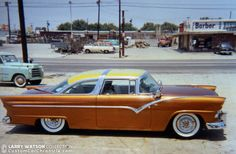 Larry Quatrone 1955 Ford Crown Victoria was restyled by Ed Schelhaas and painted a wonderful candy root beer with a pearl lime green top by Larry Watson at his Rosecrans Blvd shop in Bellflower Ca. Custom Paint Jobs, Custom Cars, Futuristic Motorcycle, Cars Usa, Ford Shelby, Old Fords, Ford Fairlane, Fancy Cars, Classic Cars