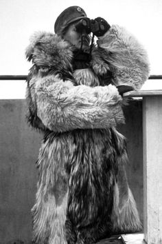 Well protected from the cold weather, a member of Finland's women's army, the Lotta Svärd, takes part in air raid precautions practice in 1940 (right).