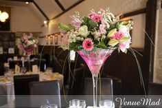 Martini glasses with flowers in for table decorations