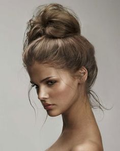 Messy bun. Love! Because I would rather pin my hair up all the time, now that it longer! :)