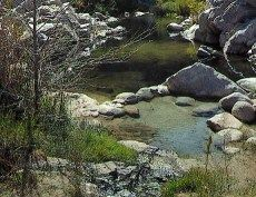 link to USA Hot Springs Database showing name/location/temp at bottom of page
