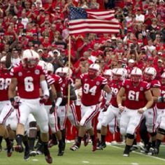 Huskers! Love the carrying the flag tradition.