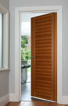 Orense Zebrano Bespoke Contemporary Style Door For Modern Homes This Made To Order Features Stunning Stainless Steel Inlays
