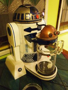 I'm not the biggest Star Wars fan, but EVERYBODY loves R2D2, right?  How cool is this coffee maker! :) It has step by step instructions to make it on www.instructables.com but *I* couldn't do it. :p