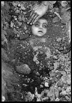 On the morning after the Bhopal disaster, press photographers Raghu Rai and Pablo Bartholomew came upon this man, burying his baby daughter.-- Bhopal Disaster of 1984 was the worst industrial disaster in the history of the world. It was caused by the accidental release of forty metric tons of methyl isocyanate (MIC) from a Union Carbide India, Limited (UCIL) pesticide plant located in the heart of the city of Bhopal
