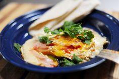 Huevos Ree-os. Eggs, Provolone or Swiss or Cheddar, Picante sauce, butter, salt, flour tortillas, cilantro