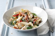 Delicious! Chicken, pasta, spinach, peppers, and garlic cream cheese sauce