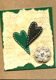 Handmade Card.Hearts on a distressed background with jute, crochet flower and butterfly brad.