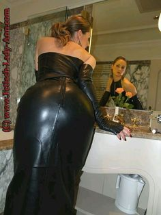 Blonde amateur in the bathroom showing her bottom in black leather skirt and fingerless opera gloves