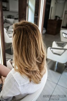 Style for long hair. To #darkblond base I added some #blonder parts. I used #gold + #pearl #toner to blend the #hilights. The look is very fresh and #sunkissed. After #colouring I used strong reconstructuring #conditioner as the client had very dry and brittle #hair.