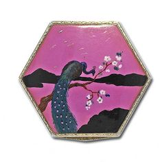 A vibrantly enameled English sterling silver compact in a hexagonal shape featuring a peacock motif with flowing colorful plumage sitting atop a flowering branch, London 1927. This compact measures 2 1/8 by 2 1/2.