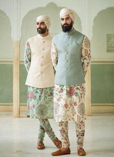 With wedding season around the corner, why stick to traditional plain kurta? Why not experiment something and get this absolutely stunning floral kurta-pajama with plain nehru jacket and be the star of the wedding? Mens Wedding Wear Indian, Wedding Kurta For Men, Mens Indian Wear, Mens Ethnic Wear, Wedding Dresses Men Indian, Indian Groom Wear, Wedding Dress Men, Indian Men Fashion, Latest Mens Fashion