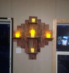 Need something for candle decoration? Here we have the idea of making wall decor shelf; it can be used for placing anything that you think can make the room look attractive. The pallets are used innovatively in this idea and copying it is not hard, just concentration is required.
