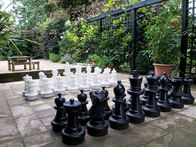 An oversized chess set makes a striking feature, the black-and-white sculptural pieces making it particularly suitable for a modern or minimalist yard with plenty of hard landscaping, or for a square of a well-kept lawn. Chess is not an obvious party game, but there are many other oversized yard games available that have been designed with outdoor gatherings in mind.