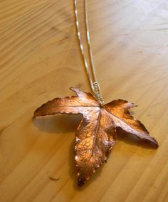 how modern and with nature can this piece get. silver chain and real oak leaf.