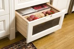 A low-level drawer with a mesh screen front is ideal for fruit and veg storage. - American Classic traditional-kitchen