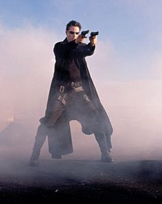 Keanu Reeves - Neo (The Matrix), I love the coat but nothing beats a holster strapped to a thigh!