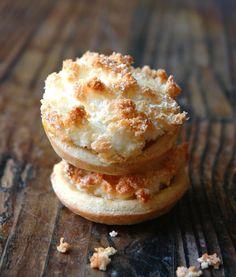Hertzoggies (Jam and Coconut Tarts) - http://www.my-easy-cooking.com/2011/03/22/jam-and-coconut-tarts-to-some-but-here-in-sa-we-call-them-hertzoggies/
