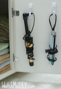 Storage for inside the bathroom vanity door! #curlingirons