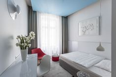 These minimalist rooms use a subtle combination of silver and white to create an airy, light ambiance. They are decorated with original artworks by contemporary Hungarian artists.