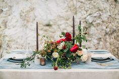 A small wedding calls for small, intimate tables, which are best to avoid cluttering. Sprinkle just a few neutral candles around a romantic centerpiece, and keep the dinnerware simple.  Via Alise Taggart