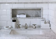 bevelled subway tiles, carrara marble vanity top, niche and frieze and nickel deco taps.