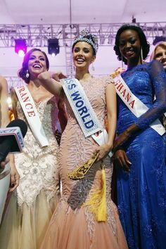 US-born Miss Philippines Megan Young won the Miss World 2013 title, standing beside Miss France, who was the first runner-up, and Miss Ghana, who was the