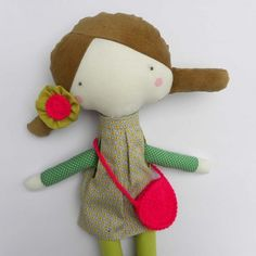 cute little gal with a flower in her hair- and ready for an outing.
