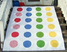 A Twister quilt!!!  Would look great on a bed or on the floor covered in twisted children!  (From Gen X Quilters)