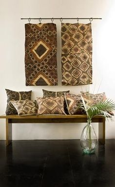 kuba cloth these cushions are fashioned from vintage fabric woven from raffia-palm leaf fibers. the swaths are traditionally worn as ceremonial dance skirts, called ntchaks, by the kuba people of the democratic republic of the congo. African Interior Design, African Design, African Style, Ethnic Design, Ethnic Style, African Textiles, African Fabric, African Prints, African Home Decor