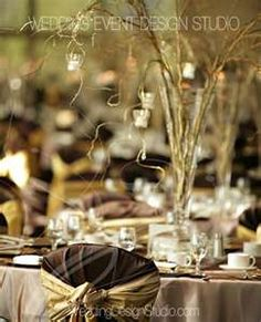 Reception decor with plaid chair covers and branch centerpieces for a fall wedding!