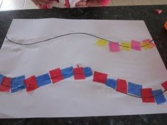 patterning activity . Curvy line and tissue paper squares