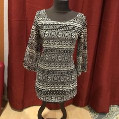 New Glory print top Beautiful long top black and white it has been used, in very good condition. New Glory Tops Blouses