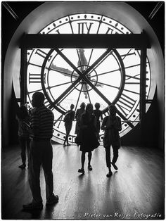Can you tell time? II  People watching the great clock on the fifth floor of the Museum D'Orsay. The Musée d'Orsay is a museum in Paris, France,. It is housed in the former Gare d'Orsay, a Beaux-Arts railway station built between 1898 and 1900. The museum holds mainly French art dating from 1848 to 1915, including paintings, sculptures, furniture, and photography.  Made with Fuji X20 B&W by SilverEfex Pro2