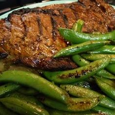 Whiskey-Marinated Steak Recipe - In this recipe, ribeye steaks sit overnight in a whiskey-based marinade with onions and garlic, before being grilled to your desired doneness. Steak Recipes, Grilling Recipes, Cooking Recipes, Sirloin Steaks, Beef Steak, Sauce Teriyaki, Marinated Steak, Butter Recipe, Butter Sauce