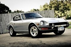 """Datsun's 240Z was a game changer in 1970, literally defining what a Japanese sports car could be to a world that had never thought of Japanese cars as more than """"econoboxes."""" And what a definition it was... beautifully proportioned and detailed with restraint American manufacturers couldn't dream of at the time, the Z car  quickly came to compete (and win) against established marques like Corvettes, Mustangs and Trans Ams. Japanese Sports Cars, Japanese Cars, Datsun 240z, Modified Cars, Corvettes, Game Changer, Mustangs, Nissan, Infinity"""