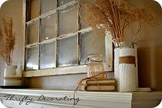 ? mantle ...burlap over books, sweaters around vases and an old window