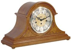 "21130-I90340 - Amelia Tambour Mantel Clock -  Beautiful styled tambour clock in an classic oak finish. With brass feet, raised burl veneer panels and a beaded molding across the bottom. Brass 8-day key wound movement plays 4/4 Westminster chimes.  Measures: H 11 3/8"" x W 18 1/8"" x D 6 1/2""   Three year manufacturer's warranty from http://www.theisenclock.com/mantel_clock.html Free shipping"