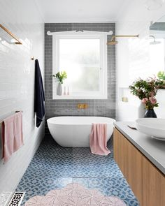 We'd imagine this is exactly the kind of bathroom that soapy dreams are made of. Pattern and texture bliss with not one, but two feature tiles! Preston Project by @gia_renovations #bathroomgoals #bathroombliss #bathroom #architecture #tileinspo