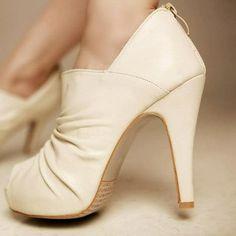 Winter white open toe booties.