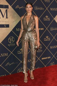 Shanina Shaik, has put on a glitzy display, arriving at Hollywood's Maxim Hot 100 event in a sparkly gold jumpsuit on Saturday night. Gold Jumpsuit, Backless Jumpsuit, Glamour, 70s Fashion, Fashion Outfits, Stage Outfits, Fashion Ideas, Silvester Outfit, Metallic Jumpsuits
