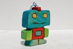 This sweet wooden robot is ready to warm your heart.    Warning: sings holiday songs in monotone. Each robot ornament is a one of a kind wooden