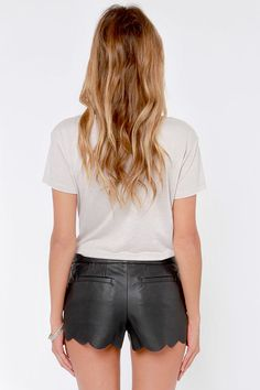 """When the stakes are high, slip into a clear winner: the Scallop the Ante Black Vegan Leather Shorts! Vegan leather begins with a banded waist, then dives past front darts and back pockets to a dainty scalloped hem. A shiny silver zipper hangs out at the left hip, with a decorative zipper at the right. Lined. Model is 5'8"""" and is wearing a size small. 75% Polyurethane, 25% Cotton. Dry Clean Only."""