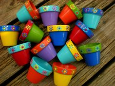 Small Painted Flower Pots for Party Favors - Set of 10 - Ready to ship by HappyMooseGardenArt on Etsy https://www.etsy.com/listing/163382895/small-painted-flower-pots-for-party