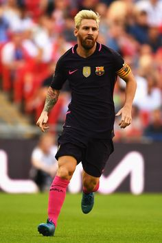 Lionel Messi of Barcelona in action during the International Champions Cup match between Liverpool and Barcelona at Wembley Stadium on August 6, 2016 in London, England.