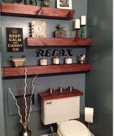 beautiful shelves - love that they are offset and love the wood cover on the tank of the toilet, too