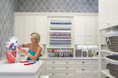 Martha O'Hara Interiors - Love this craft room! Wrapping station, white cabinets, gray ...